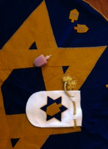 This is a dreidel game I made about 15 years ago from a pattern by Martha Stewart